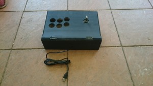 Spray painted box with Joystick mounted and USB cable attached